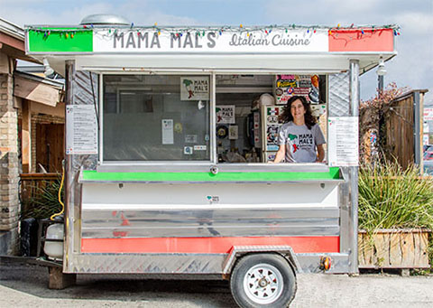Mama Mal sits cooking in her Austin, Texas based food truck