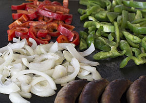 Red bell peppers, green bell peppers and white onions combine on the grill for an Italian theme